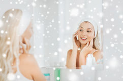 Woman in hairband touching her face at bathroom Stock Photography