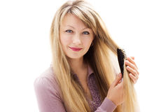 Woman and hairbrush Royalty Free Stock Photography