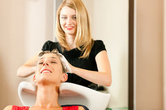 Woman at the hairdresser stock image