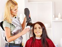 Woman at hairdresser. Stock Photos