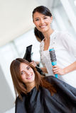Woman at the hairdresser Royalty Free Stock Photography