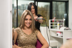 Woman Hairdresser Do Hairstyle Girl In Beauty Salon Stock Photography