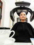 Woman in hairdresser, drying hair under machine Royalty Free Stock Photography