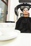 Woman in hairdresser, drying hair under machine Royalty Free Stock Images