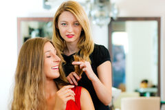 Woman at the hairdresser getting advise Stock Images