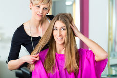 Woman at the hairdresser getting advise. On her hair styling royalty free stock images