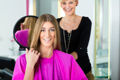 Woman at the hairdresser getting advise Stock Image