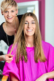 Woman at the hairdresser getting advise. On her hair styling royalty free stock photo