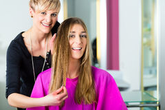 Woman at the hairdresser getting advise. On her hair styling stock images