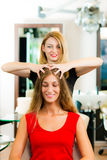 Woman at the hairdresser getting a head massage Royalty Free Stock Photos