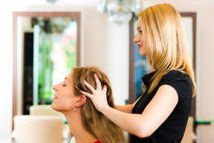 Woman at the hairdresser Royalty Free Stock Images