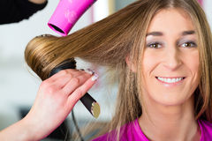 Woman at the hairdresser having hair dried Royalty Free Stock Images