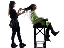 Woman and hairdresser silhouette Royalty Free Stock Photography