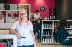 Woman hairdresser standing in hair and beauty salon Royalty Free Stock Photo