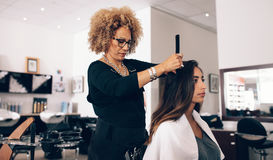 Woman hairdresser at work in salon Stock Photography