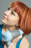 Woman with hairdryer Stock Photo