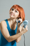 Woman with hairdryer Royalty Free Stock Photography