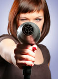 Woman with hairdryer. Girl with hairdryer, focus on hairdryer Royalty Free Stock Images