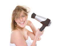 Woman with hairdryer Stock Photography