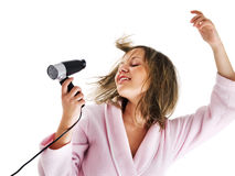 Woman with hairdryer Royalty Free Stock Images