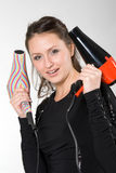 Woman with hairdryers Stock Images