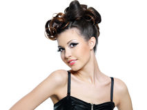 Woman with hairstyle. Beautiful smiling young brunette woman with fashion hairstyle - isolated royalty free stock photos