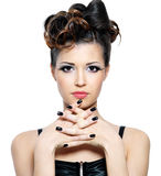Woman with hairstyle and black fingernails. Attracitve woman with stylish hairstyle and black nails. Fashion eye make-up royalty free stock images