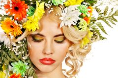 Woman with make up and flower. Woman with hairstyle and flower. Isolated Stock Image