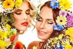 Woman with make up and flower. Royalty Free Stock Images