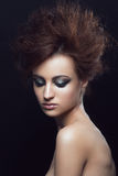 Woman with hairstyle and makeup Stock Image