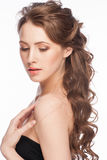 Woman with hairstyle. Portrait of Beautiful Caucasian Woman with Long Brown Curly Hair. Bridal hairstyle, isolated on white background Royalty Free Stock Photography