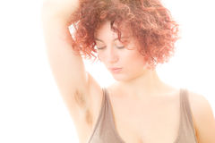 Woman with Hairy Armpit. Pretty Woman with Hairy Armpit on White Background Stock Photo