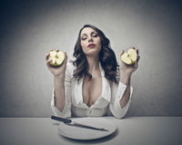 Woman with an apple. Woman with half apple in each hands Royalty Free Stock Image