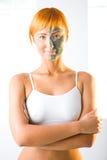 Woman in half facial mask Royalty Free Stock Photo