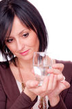 Woman and half full glass of water Stock Photo