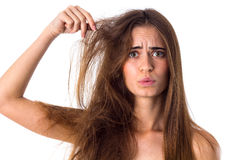 Woman with half of hair straight and half tangled Stock Photo