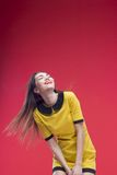 Woman half length on red background. Young excited woman with emotions standing half length portrait isolated on red Stock Photo