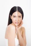 Woman with half light half dark skin. Beautiful young woman with half light half dark skin isolated on white background Royalty Free Stock Photos