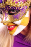 Woman in the half mask Royalty Free Stock Image