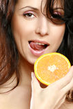 Woman with half orange Stock Photo