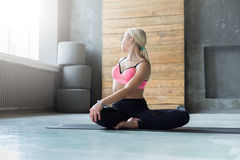 Woman in half-turn Lotus parivrtta Ardha Padmasana Royalty Free Stock Photos