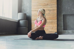 Woman in half-turn Lotus parivrtta Ardha Padmasana Royalty Free Stock Images