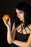 Woman with halloweeen make up  holding  peach Royalty Free Stock Photo