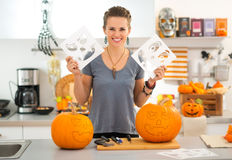 Woman with Halloween carving patterns preparing for party Stock Photo