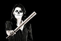 Woman in Halloween costume with a baseball bat Stock Photos