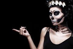 Woman in Halloween costume of Frida Kahlo with copy space. Skeleton or skull makeup. Royalty Free Stock Photos