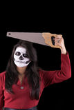 Woman in Halloween costume with a saw Stock Images