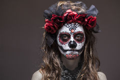 A woman in Halloween costume and skull makeup Royalty Free Stock Photo
