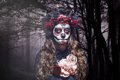 A woman in Halloween costume and skull makeup Stock Image