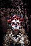 A woman in Halloween costume and skull makeup Stock Photography